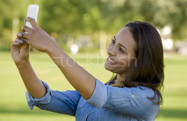 Beautiful woman taking a photo Stock photo © iko