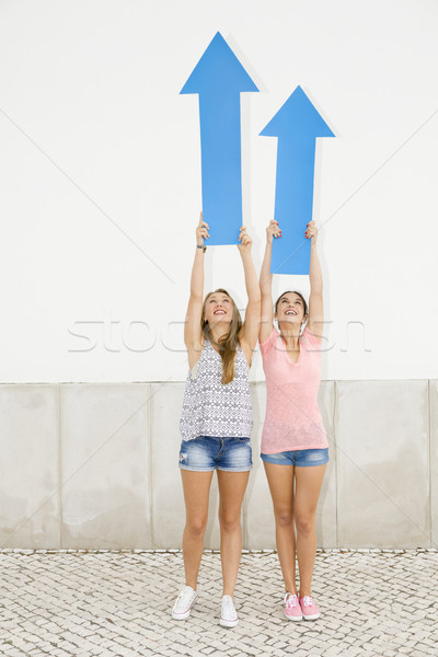Teenagers pointing blue arrows Stock photo © iko