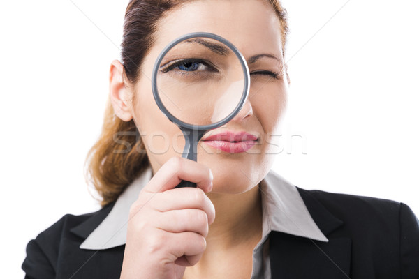 Business holding a magnifying glass Stock photo © iko