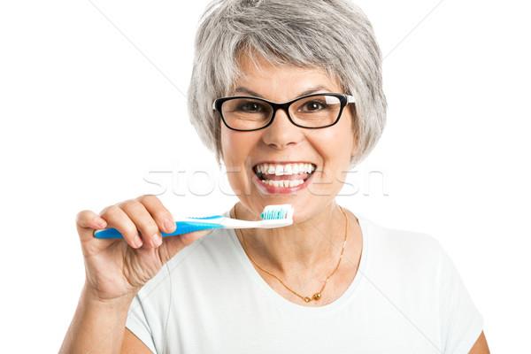 Brushing teeth Stock photo © iko