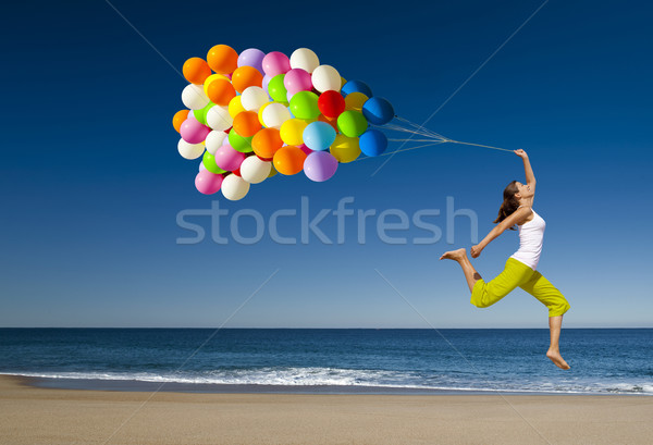 Jumping with balloons Stock photo © iko