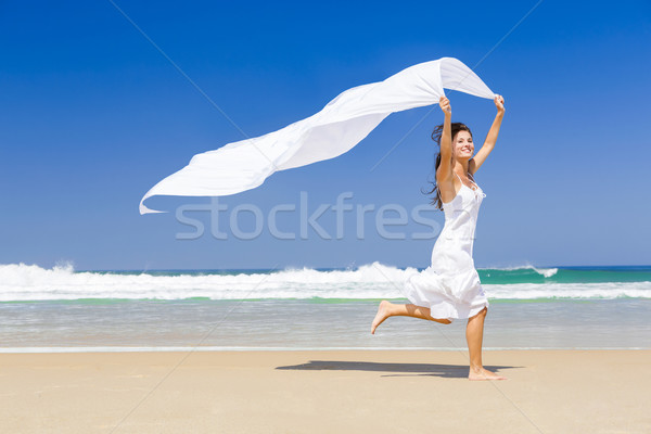 Ugrik fehér papírzsebkendő gyönyörű nő fut tengerpart Stock fotó © iko