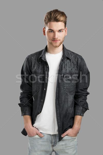 Di bell'aspetto giovane sorridere mani isolato grigio Foto d'archivio © iko