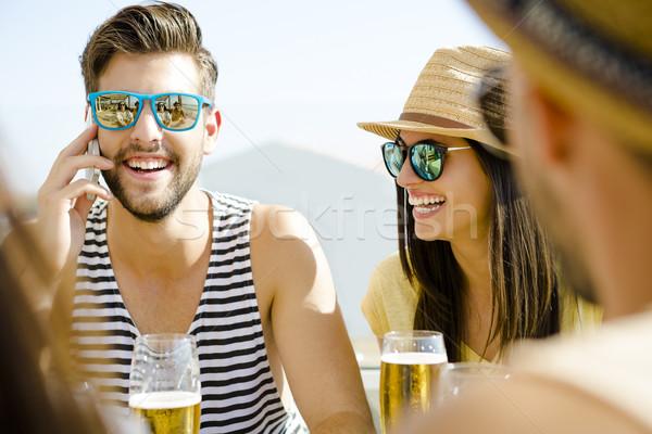 Friends at the beach bar Stock photo © iko