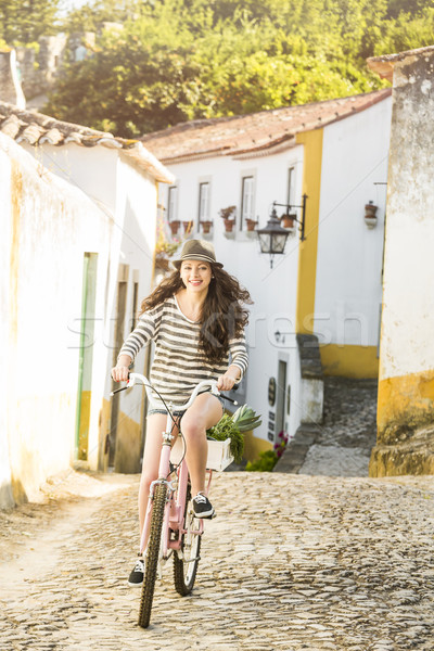 Happy girl riding a bicycle  Stock photo © iko