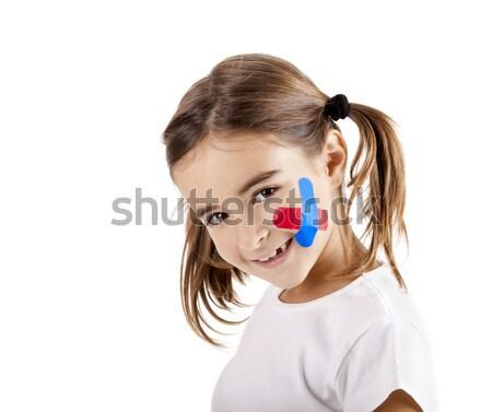 Meisje wond zwachtel gezicht geïsoleerd witte Stockfoto © iko