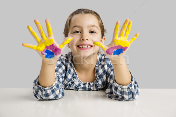Little girl with hands in paint Stock photo © iko