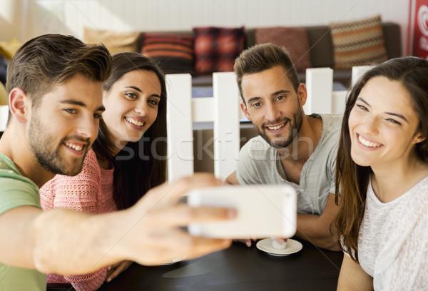группа кофейня друзей телефон женщины Сток-фото © iko