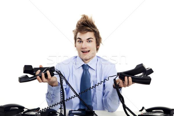 Többszörös idő fiatalember ül iroda néhány Stock fotó © iko