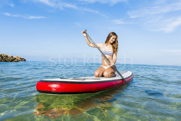 Woman practicing paddle Stock photo © iko
