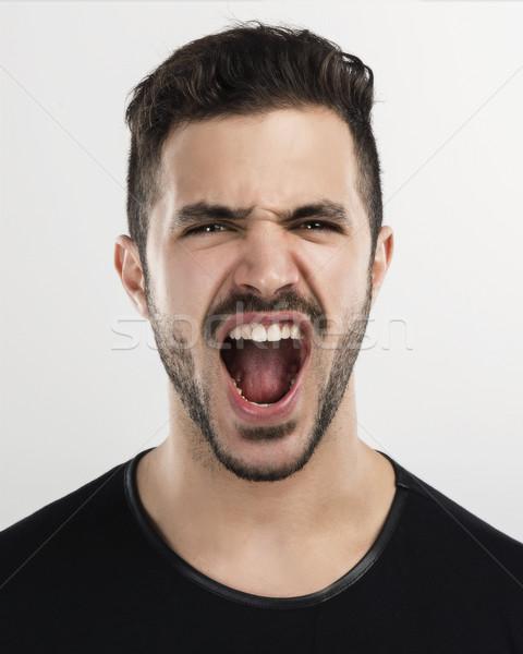 Férfi kiabál stúdió portré jóképű fiatalember Stock fotó © iko