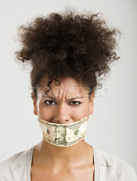 Covering mouth with a dollar banknote Stock photo © iko