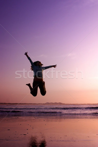Sautant plage femme exercice ciel sport Photo stock © iko