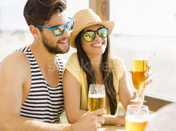 Stock photo: Friends drinking a cold beer