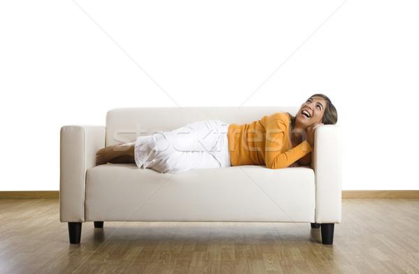 Relaxante casa bela mulher risonho sofá feliz Foto stock © iko