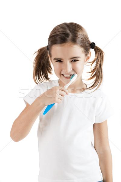 Oral temizlik küçük kız yalıtılmış beyaz Stok fotoğraf © iko