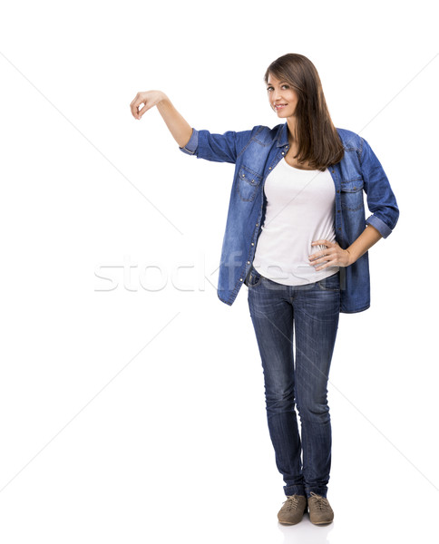 Beautiful woman holding and showing something over a white background Stock photo © iko