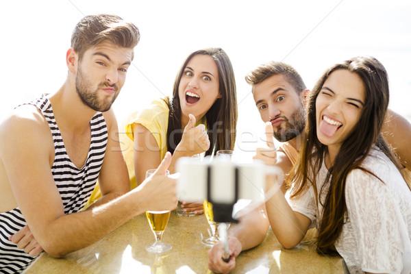 Group selfie at the beach bar Stock photo © iko