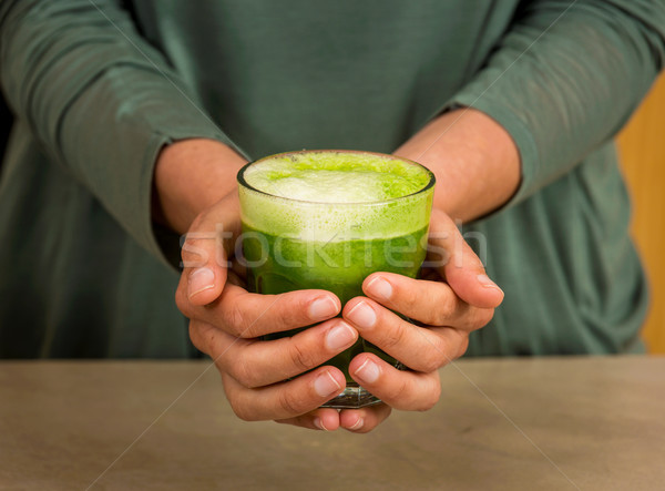 Detoxikáló dzsúz nő tart üveg zöld Stock fotó © iko