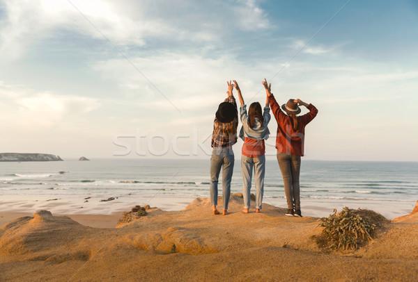 Girls looking the ocean Stock photo © iko
