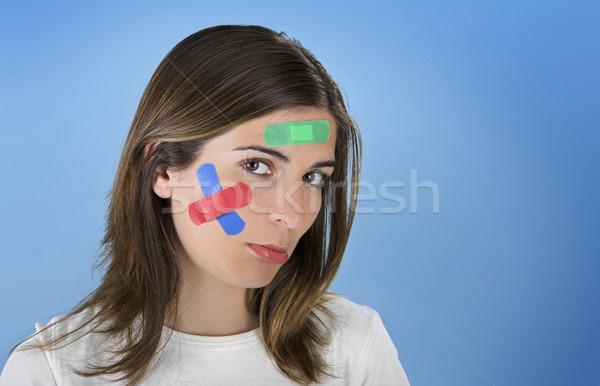 Woman with a cross bandages Stock photo © iko