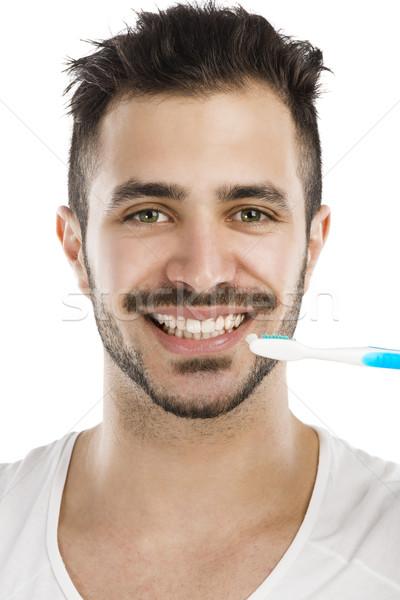 Man brushing the teeth Stock photo © iko