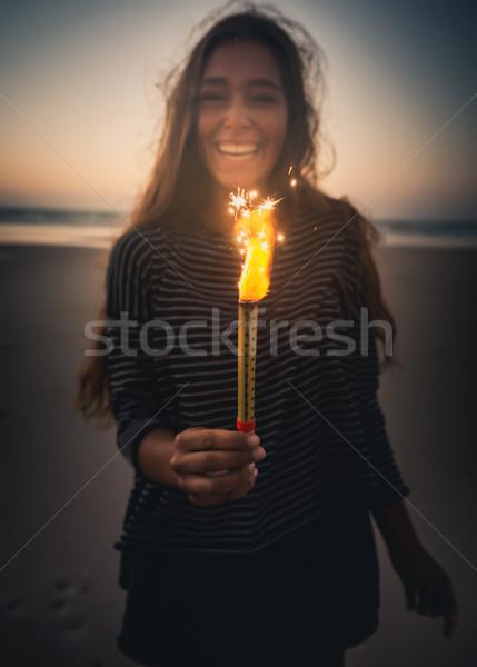 Dziewczyna fajerwerków plaży uśmiech Zdjęcia stock © iko