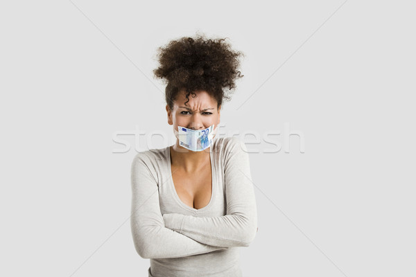 Covering mouth with a euro banknote Stock photo © iko