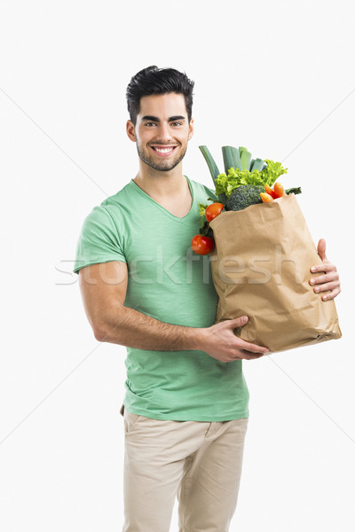 Man carrying a bag full of vegetables Stock photo © iko