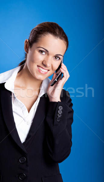Businesswoman calling at phone Stock photo © iko