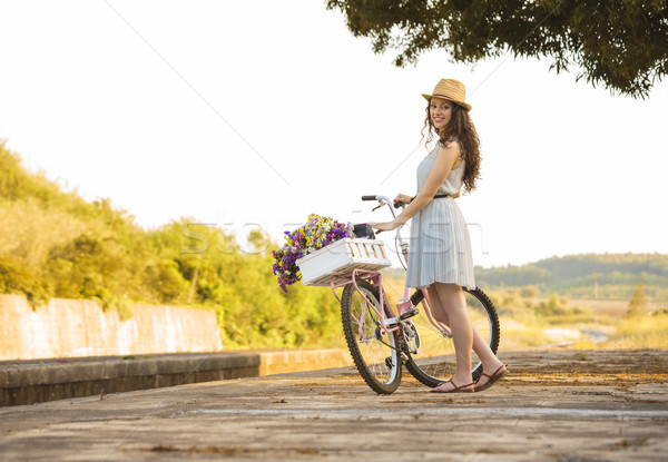 Happy girl with her bicycle Stock photo © iko
