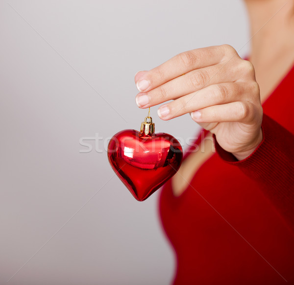 Holding a Christmas-tree decoration Stock photo © iko
