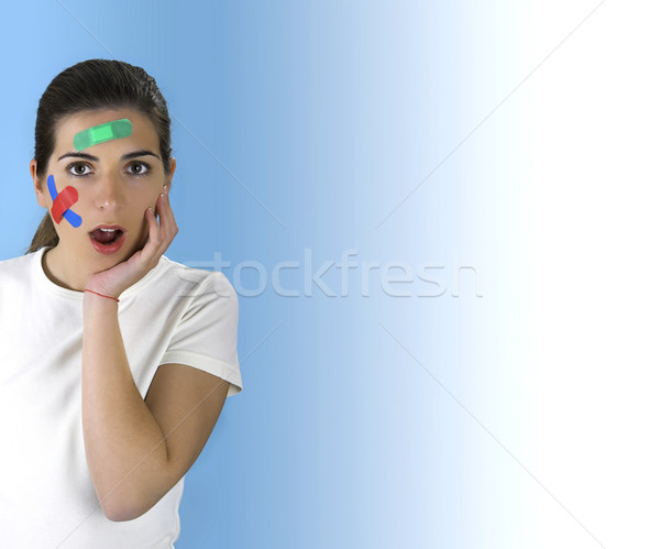 Stock photo: Surprised Woman with bandages on the face