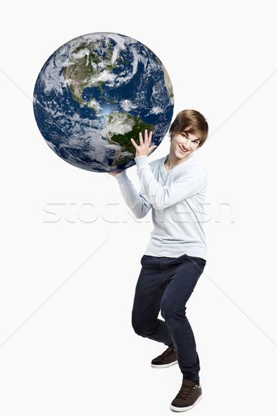 планете Земля красивый молодым человеком рук изолированный Сток-фото © iko