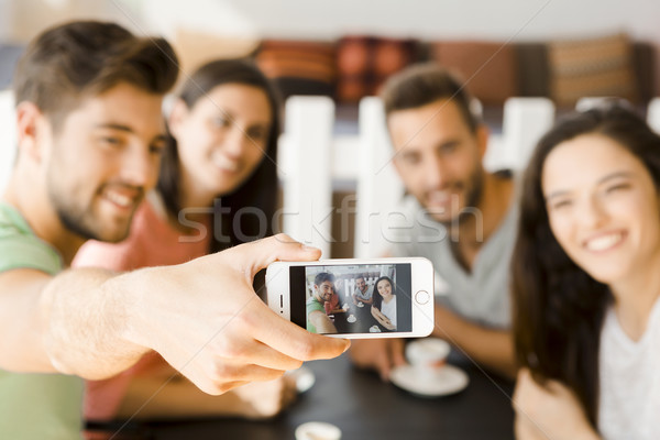 Group selfie at the coffee shop Stock photo © iko