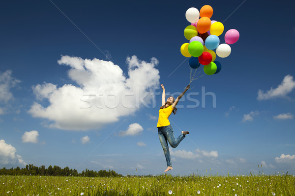 Uçan balonlar mutlu genç kadın renkli Stok fotoğraf © iko