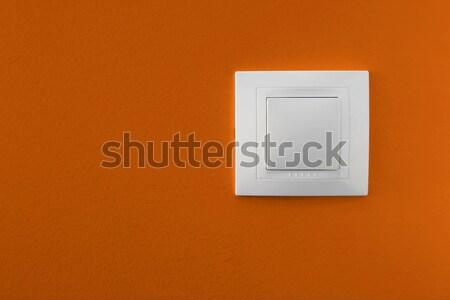 Interruttore della luce semplice arancione muro sfondo energia Foto d'archivio © iko