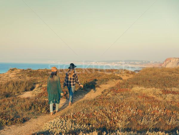 Girs walking ove the coastline Stock photo © iko
