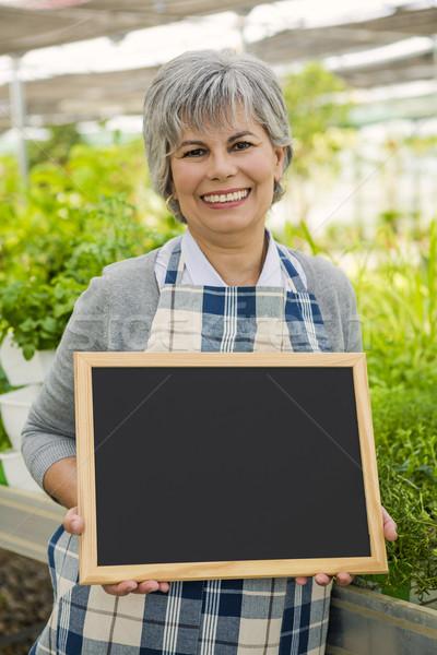 Mujer madura invernadero pizarra Foto stock © iko