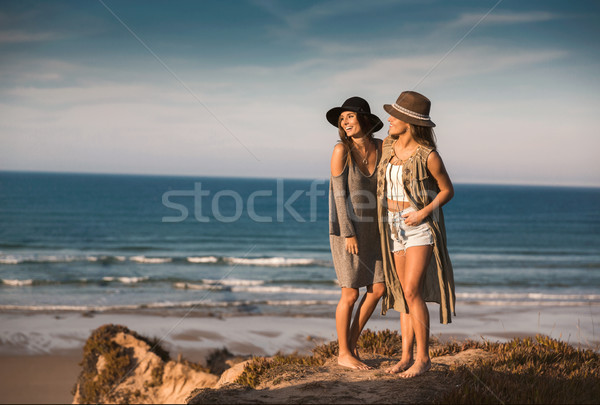 Beautiful girls on the beach Stock photo © iko