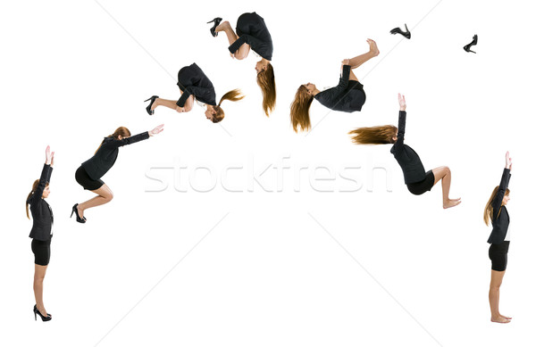 Business woman making  a front flip Stock photo © iko