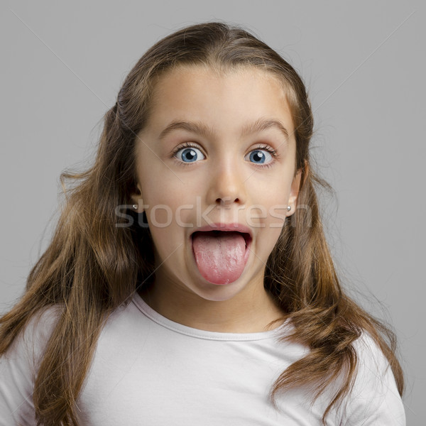 Girl with tongue out Stock photo © iko