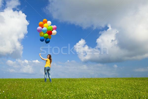 Girl with colorful balloons Stock photo © iko