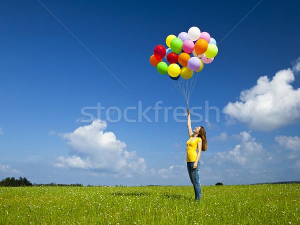 Kız renkli balonlar mutlu genç kadın yeşil Stok fotoğraf © iko