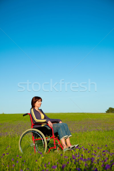 Handicapped woman on wheelchair Stock photo © iko