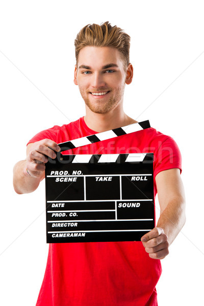 Young man holding a clapboard Stock photo © iko