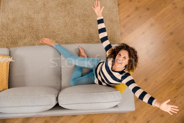 Happy woman at home Stock photo © iko