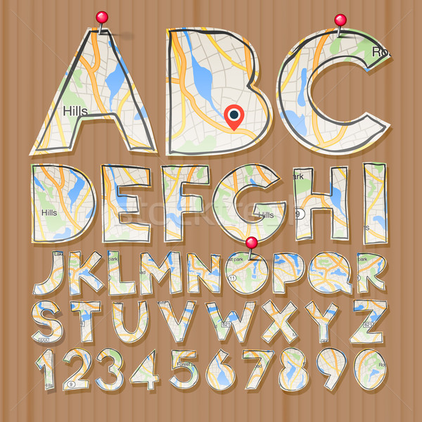 Alphabet and numbers, paper craft design, cut out by scissors from map Stock photo © ikopylov