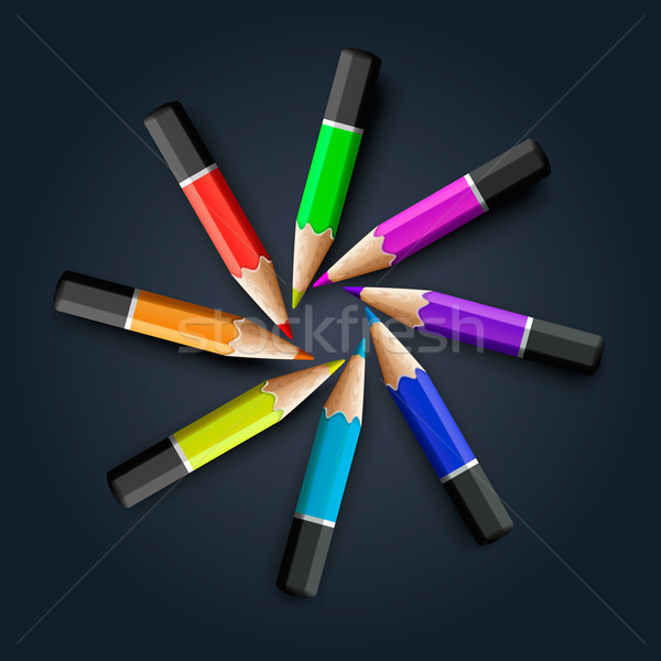 Colored pencils on grey background Stock photo © ikopylov