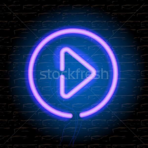Neon music play button on the brick wall Stock photo © ikopylov